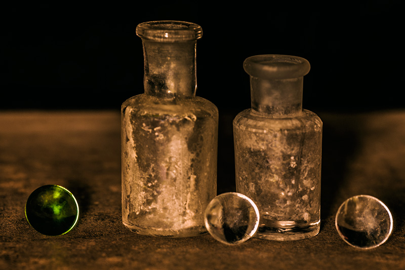 Two Old Bottles and Three Orbs
